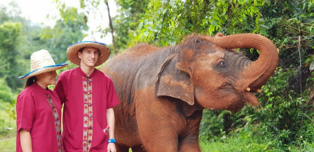 Claire Ketterer and Nicolas Moser with a baby elephant