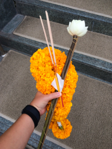 A lotus flower, a flower crown and incense: what is needed for a Buddhist ritual