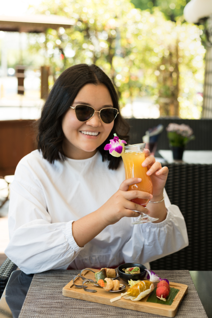 Claire Ketterer drinking a Phuket Sunset Cocktail at the Patara restaurant