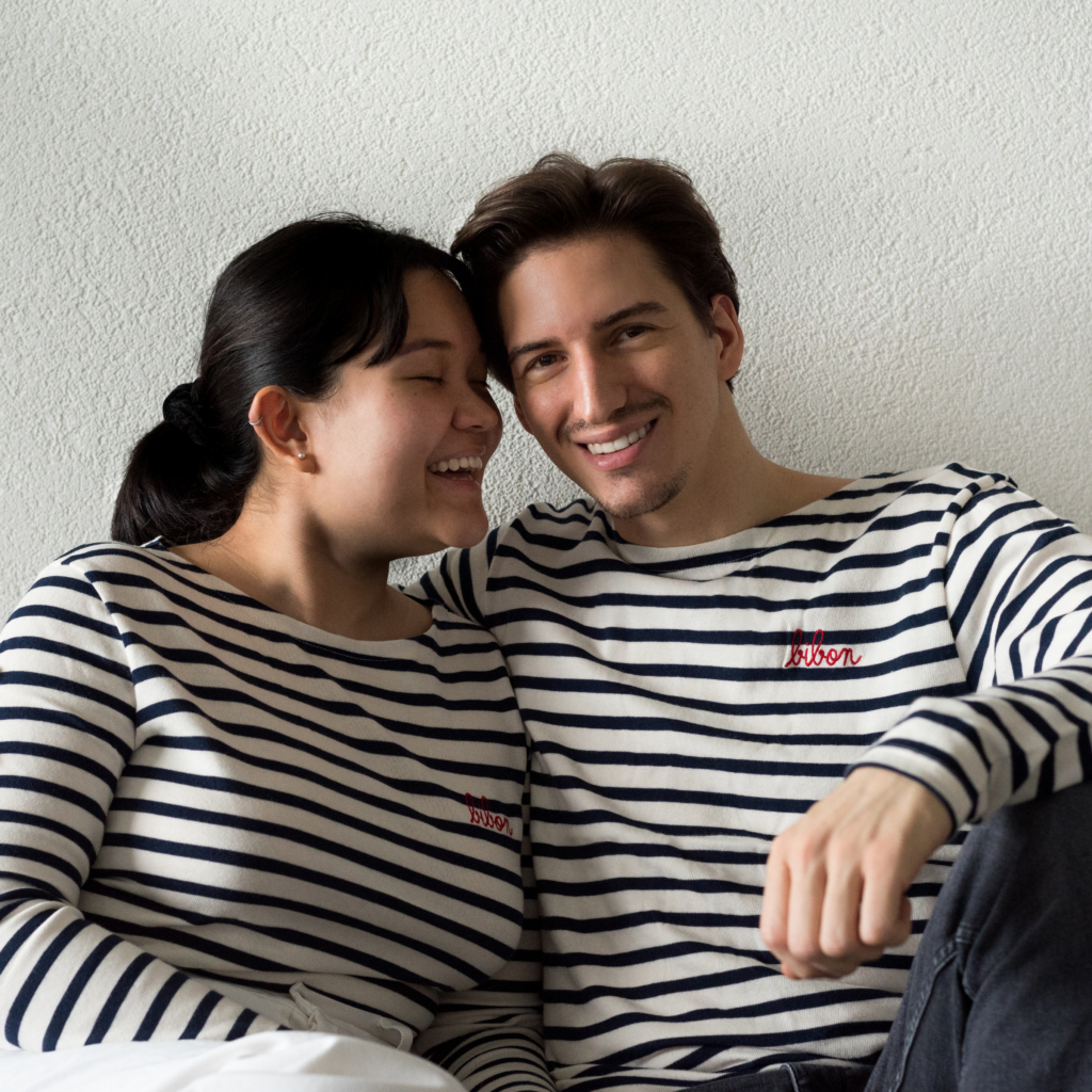 Claire and Nicolas wearing matching striped shirts
