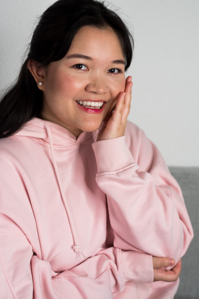 Claire smiling and wearing a Korean-inspired makeup look