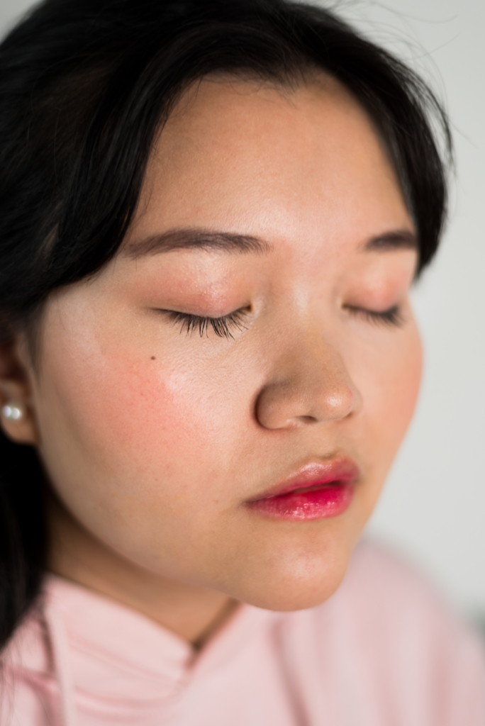 Close-up of Claire wearing a Korean-inspired makeup look created using only Clarins products