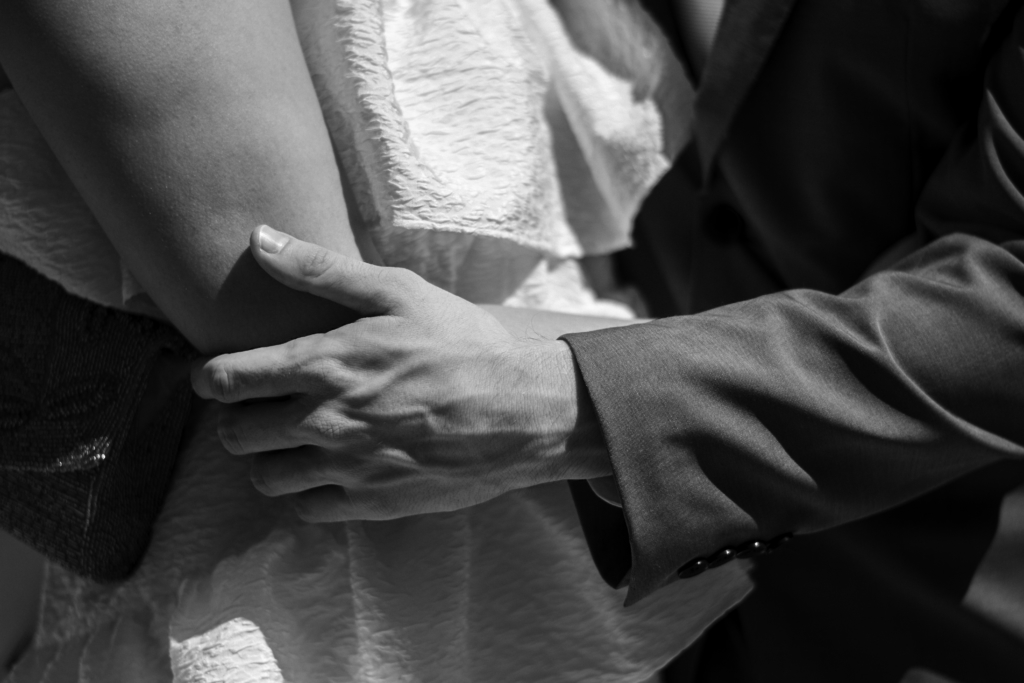 Detail of Claire and Nicolas's arms while embracing