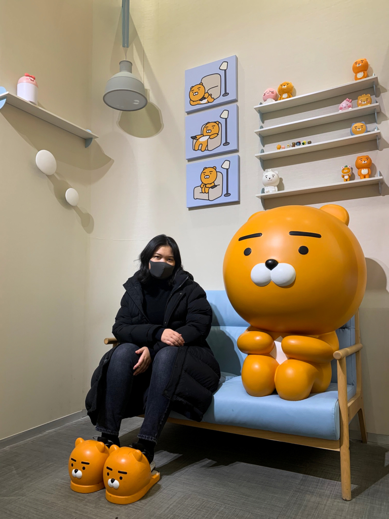 Claire and a real-life sized Ryan mascot in a Kakao Friends Store in Seoul